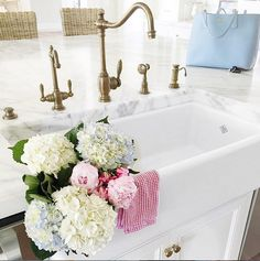 Kitchen Island with Farmhouse sink and brass kitchen faucet. Via Pink Peonies.