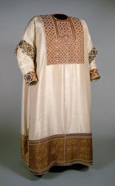 Much of trimming dates to 1181, square trimming around neck dates to 13th century, and white silk dates to 18th century.  Traces of original fabric still exist under silk lining.  Early history of this piece mentioned in embroidery inscription in both Latin and Arabic which says it was made in Palermo 1181 for William II of Sicily.