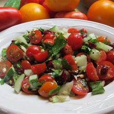 Cherry Tomato Salad - Allrecipes.com Tried this & tweaked with what I had... chopped fresh tomatoes, black olives (no green), sweet onion chopped, no nuts & replaced vinegar w/ balsamic... Served over romaine lettuce.  Still delicious!  (probably a completely different recipes!)