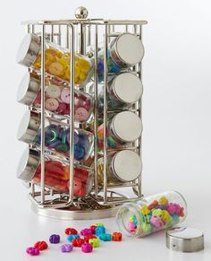 A spice rack with empty spice jars can help organize buttons by color or size. Not only is it a convenient way to store small embellishemtns, but it looks pretty on your sewing table!