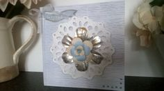 Used a Colour Cloud ink on a woodgrain textured card (also thought it could do for water). Gilded the larger layer of the flower with gilding flakes and used a Sizzix Biz die for the doily layer. X