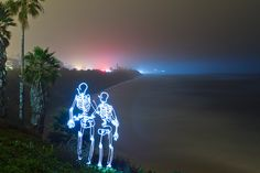 Light paintings: A romantic skeleton couple created using a 180 second exposure featured in the guardian Light Painting Photography, Landscape Photography, Dinosaur Light, Angeles, Couple Art, Skull And Bones, People Photography, Light Art, The Guardian