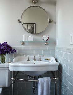 Design Chic - love the round mirror and pedestal sink  in the bathroom