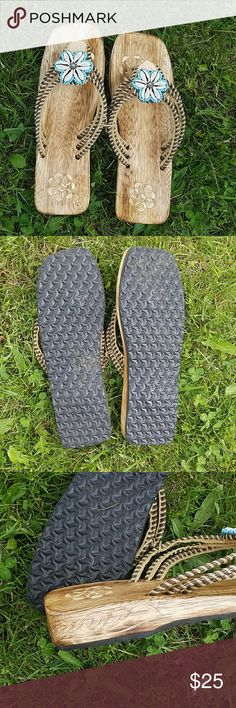 Handcrafted Hawaiian sandals Really cool wooden flip flops with foam on the bottom and a beautiful she'll design. Never worn. Shoes Sandals