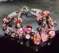 107 - beaded bracelet. Pink rose flower white copper bronze lampwork glass Swarovski crystal square round beads, silver findings. on Etsy, $30.00