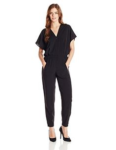1115803d14e Kimono-sleeve Black jumpsuit with zippered front featuring elasticized  waistband and side pockets. It has got Elasticized cuffs.