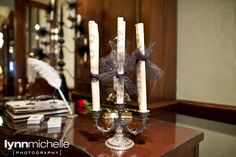 couture wedding, sheet music rolled up in black ribbon on vintage candle holder.