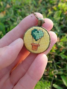 Green hot air balloon Embroidery necklace Cross stitch pendant Heart jewelry Hand embroidery Travel jewelry Joyful gift Air balloon pendant - Informations About Green hot air balloon Embroidery necklace Cross stitch pendant Heart jewelry Han - Tiny Cross Stitch, Cross Stitch Designs, Cross Stitch Patterns, Hand Embroidery Stitches, Cross Stitch Embroidery, Modern Embroidery, Diamond Bar Necklace, Green Necklace, Good Luck Necklace