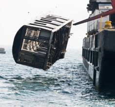"""photojojo: """" Stephen Mallon photographs retired NYC subway cars as they're carted off to their Ocean grave in Next Stop, Atlantic. View full-screen for full effect. """""""