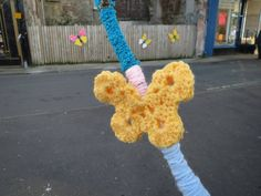 Crochet butterfly over looking the butterfly community art work on Guildford Square Crochet Butterfly, Yarn Bombing, Community Art, Art Work, Crochet Necklace, Creative, Fabric, Projects, How To Make