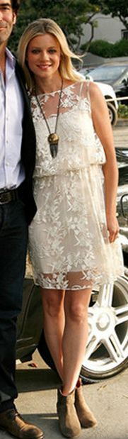 Amy Smart - chunky pendant & flat booties dress down a lacey little white dress. Would love this with flat sandals as well