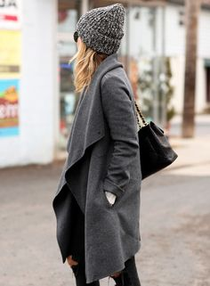 Winter Outfits: Helena Glazer is wearing a grey coat from Vince, black jeans from Rag & Bone and the grey hat is from Denim & Supply #style