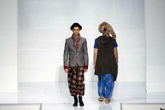 Models present creations by Afdlin Shauki during the Islamic Fashion Festival at Kuala Lumpur Fashion Week