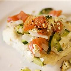 "Baked Halibut Steaks | ""An Italian-style vegetable and feta cheese topping is the perfect enhancement to delicious baked halibut."""