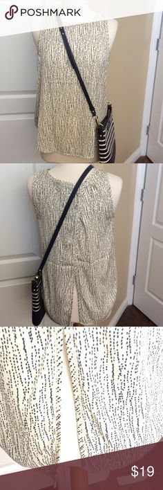 Tart silky cross back tank M Never worn . With tags .  tank with cross back. Super cute on. True to size . Bought at nord rack. Looks good with the Kate spade cross body I have listed separately. Tart Tops Tank Tops