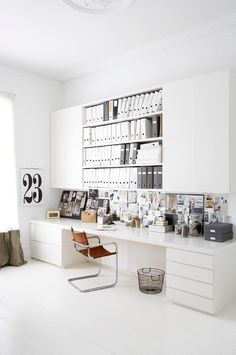great white desk area. Love the leather chair