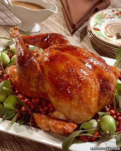 Cranberry-Glazed Turkey with Cranberry-Cornbread Stuffing -   This turkey roasts on a bed of red onions and is basted liberally with a butter and white wine while it cooks. A cranberry-maple glaze is brushed over the turkey during the last 15 minutes of roasting to add a flavorful finish