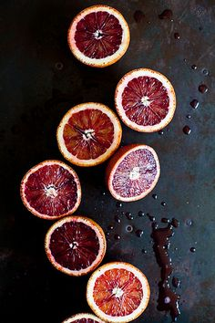 Blood Oranges by tartelette, via Flickr - the simplicity of this shot is amazing - composition but add of droplets creates drama