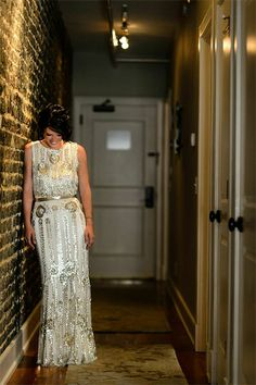 "A Jenny Packham dress from White on Daniel Island. The tastefully beaded dress became the most beautiful article of clothing the bride has ever owned. ""If I could only get an invite to the Academy Awards, I might actually have an excuse to wear it again,"" she said"