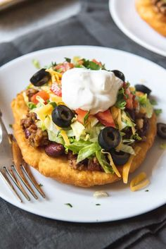 Deliciously crispy on the outside, soft and chewy on the inside, Navajo Tacos made with Indian Fry Bread are topped with a meaty mixture of taco seasoned ground beef and beans, then all the fixings Indian Taco Recipes, Mexican Food Recipes, Beef Recipes, Cooking Recipes, Cheap Recipes, Seafood Recipes, Easy Recipes, Salad Recipes