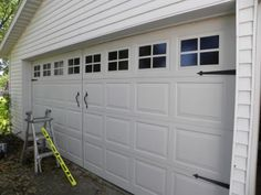 Garage door facelift:  Faux garage door windows and carriage door hardware