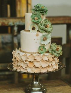 Jasmine of the The Couture Cakery created a petite cake designed with ruffly texture and rustic color. The cake was set amongst other sweets styled atop lace spools and colorful cigar boxes; photo: Jillian McGrath