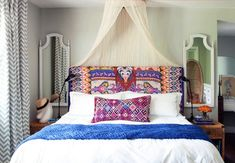 DIY Swag/Canopy Beds - This One Uses an Embrodiery or Hula Hoop.  Other ideas are pictured on this site.