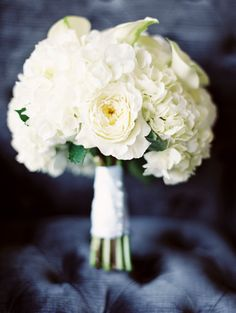 elegant white rose, hydrangea and lily bouquet by Sara King, Park Florist