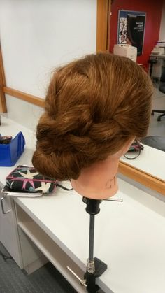 Up do with twisted plaits