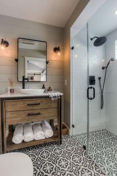 Love this farmhous bathroom! Wood vanity, patterned floor, black accents, sconces & shiplap.  Love the tile!