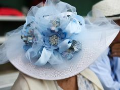 Carrie Geis, 79, in her hat for Oaks Day. She and her husband, Donald, were celebrating their 50th wedding anniversary. May 2, 2014