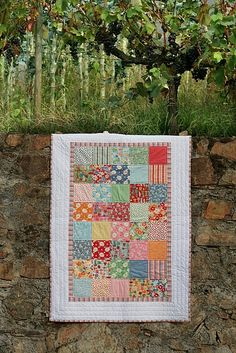patchwork quilt ~ such a lovely way to use a coordinating charm or layer cake