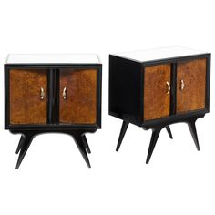 Italian 1950s Modernist set of end tables with ebonized frames and burl ash doors finished with a French polish, mirror tops, and gilded bronze handles