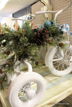 White spray paint, greenery, a few ornaments & an old tricycle. LOVE it!!