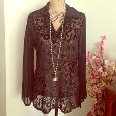 Perfect vintage blouse from NYC! Black sheer blouse with velvet floral burnout detail on front. Long sleeve with open neckline. Wear a camisole underneath or just a lacy bra if you're feeling sassy. Extra long tunic length, blousey fit so ideal for multiple sizes. 100% rayon. Perfect condition. Make me an offer! Vintage Tops Blouses