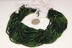 1strand  multy vederlite toutmaline faceted rondel sized by 3yes