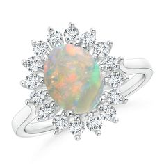 Make a statement with this An oval opal is nestled amid a glorious halo of glimmering round diamonds. The colorful gemstone and the diamonds are secured in prong settings and create a stunning floral design. This elegant sunflower opal ring in 14k white gold exudes feminine charm. from Angara.com. Explore a fascinating array of designs