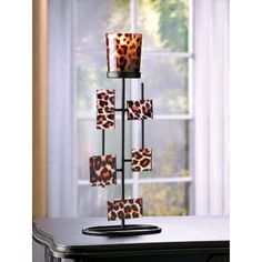 Geometric Leopard Votive Stand from Koehlerhomedecor.com  - A lively leopard print and quirky mirrored shapes turn this simple candleholder into a decorating sensation! The addition of your favorite votive fills your surroundings with an exotically enchanting glow. #home #decor #gifts Wholesale price: $7.98