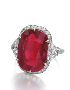 "Important Burmese ruby and diamond ring: The cushion-shaped ruby weighing 14.45 carats, mounted within a surround of demi-lune and brilliant-cut diamonds, the shoulders similarly set. ""A natural ruby from Burma of this size and quality is very rare and exceptional."""