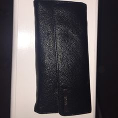 Kenneth Cole black leather wallet Kenneth Cole black leather wallet. 7 card slots, I.D. slot. Slot for coin pouch shown on last photo. 2 large long slots for bill or receipts. Large zippered slot on the back. Kenneth Cole Reaction Bags Wallets