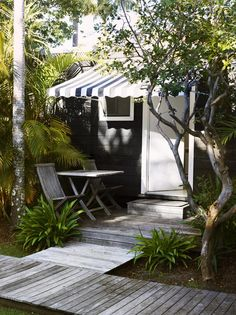 Charcoal guest room with a smart striped awning at @Atlantic Byron Bay, as seen on @The Design Files.