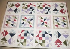 "Baby or Lap Patchwork Quilt in white, blue, pink, green and lilac sampler blocks and white sashing 55"" x 41.5"" (140x105cm)"