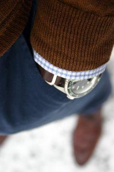 Brown sweater, light blue gingham shirt, navy pants