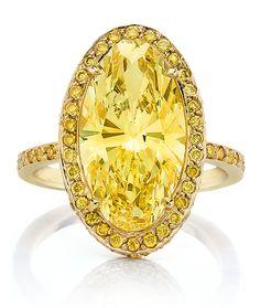 Fancy Yellow Oval Cut Diamond Ring.