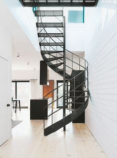 Bright modern entryway with a spiral staircase
