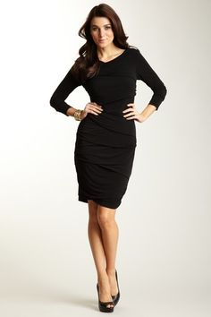 Take a classic silhouette and make it your own with this beautifully designed draped dress.