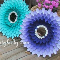 Stunning DIY Sunburst Mirror.. I CANNOT believe what these are made from