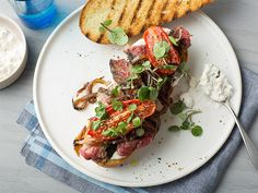 Top steak sandwiches with a homemade blue cheese sauce, plus onions, roasted tomatoes and watercress. Sandwiches may be named after an earl, but these babies are fit for a king.