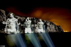 David Beckham's H underware ad has been projected onto the White Cliffs of Dover to help welcome tourists to Britain