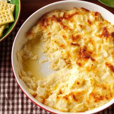 Vidalia Onion Swiss Dip Recipe -I've got one of those sweet, creamy dips you can't resist. Bake it in the oven, or use the slow cooker to make it ooey-gooey marvelous. —Judy Batson, Tampa, Florida